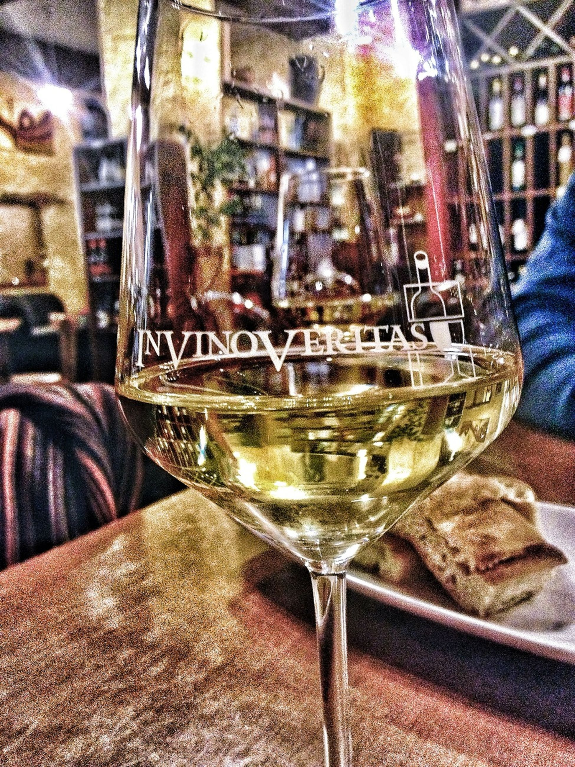 food and drink, drink, glass - material, indoors, refreshment, transparent, close-up, drinking glass, alcohol, incidental people, text, focus on foreground, freshness, built structure, architecture, restaurant, day, glass