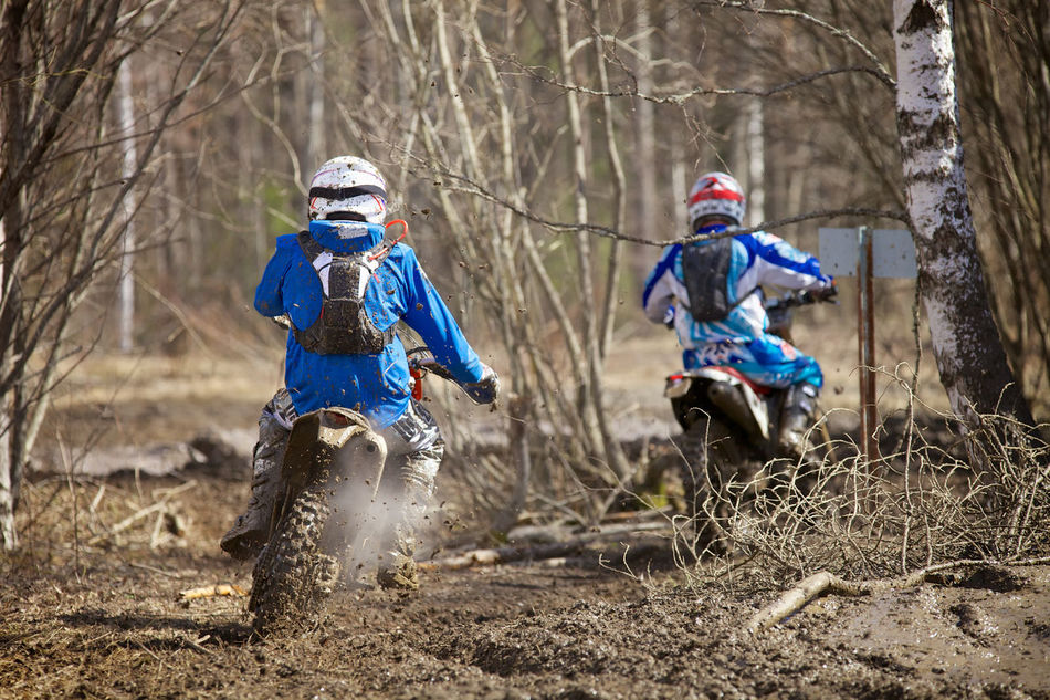 Motocross racers on wet and muddy terrain. Act Adrenaline Junkie Bike Cross-country Dirt Bike Dirty Enduro Racing Extreme Extreme Sports Fun Motion Motocross Motocross Race Motor Sport Motorbike Motorcycle Multi Colored Off-Road Offroad Outdoors Power Rider RISK Speed Trail