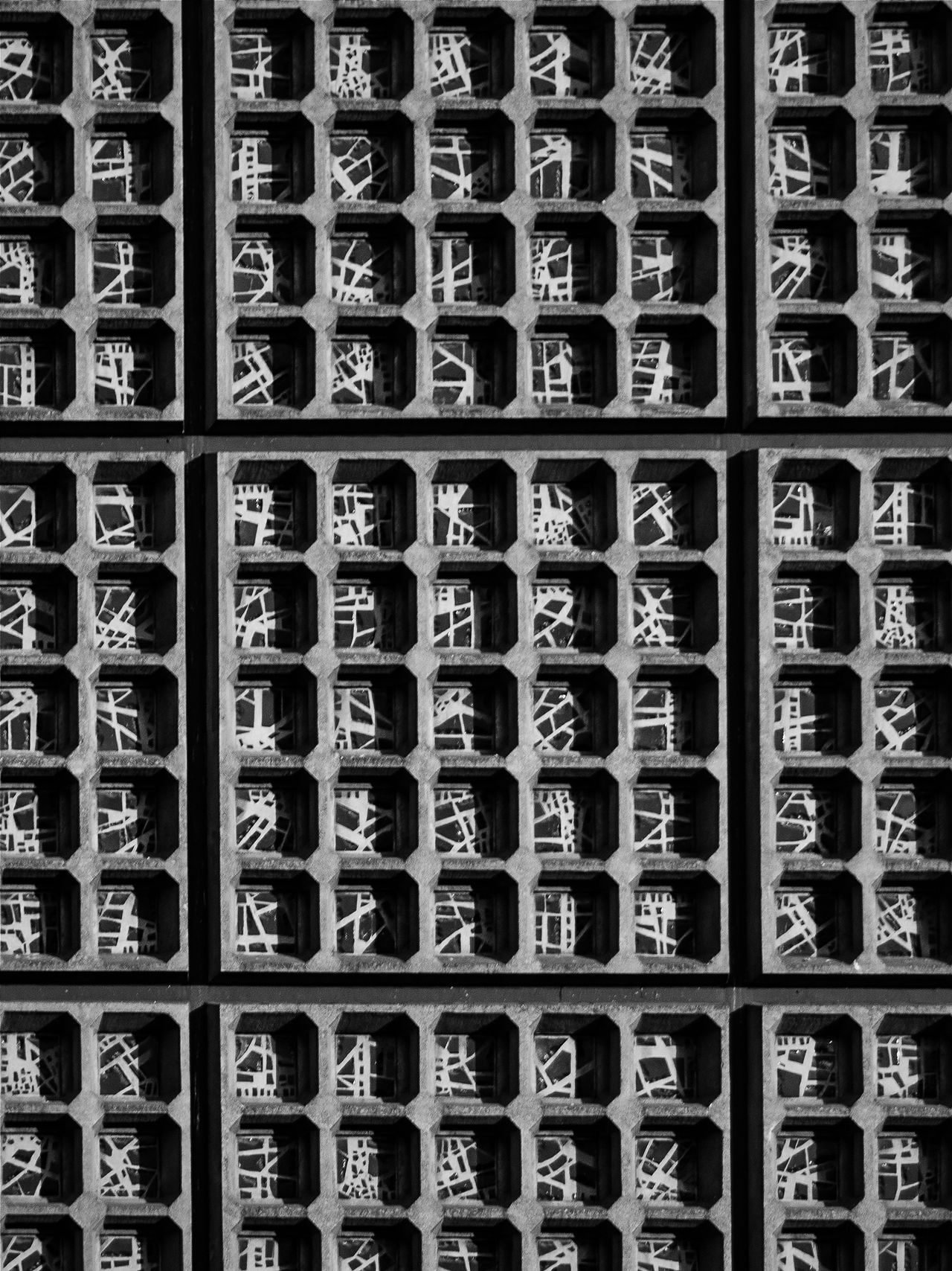 """Bnw_friday_eyeemchallenge Fragmented glass Texture a bit closer...every """"brick"""" is diffrent but all have the same dimentions...quite interesting combination of indviduality and uniformity...blue glass fragments and kind of concrete filling... Same Same But Different Black And White Texture"""