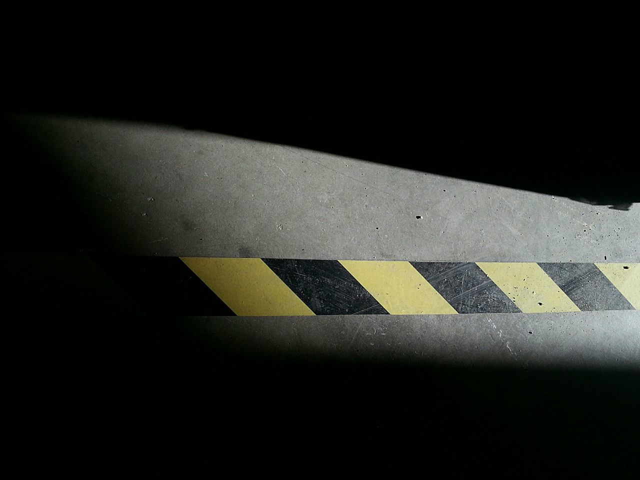Caution LINE Caution Tape Symbolic  Shadowplay Everything In Its Place Concrete Concrete Floor Simplicity Minimalism Simple Things Caution Sign Up Close Street Photography Yield Guiding Straight Lines Yellow And Black Simple Shadow And Light Conceptual Everyday Objects Dotted Line Design Concept Angles And Lines Angles