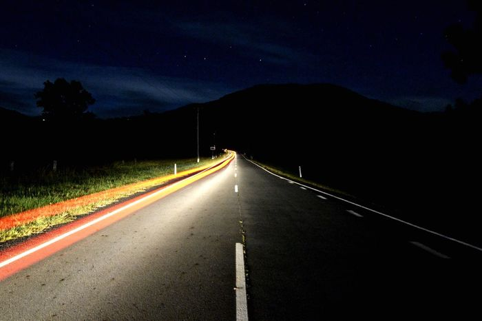 Peaceful in the valley of the mountains Night Road Light Trail Long Exposure Mountain Motion Outdoors Illuminated Sky Car
