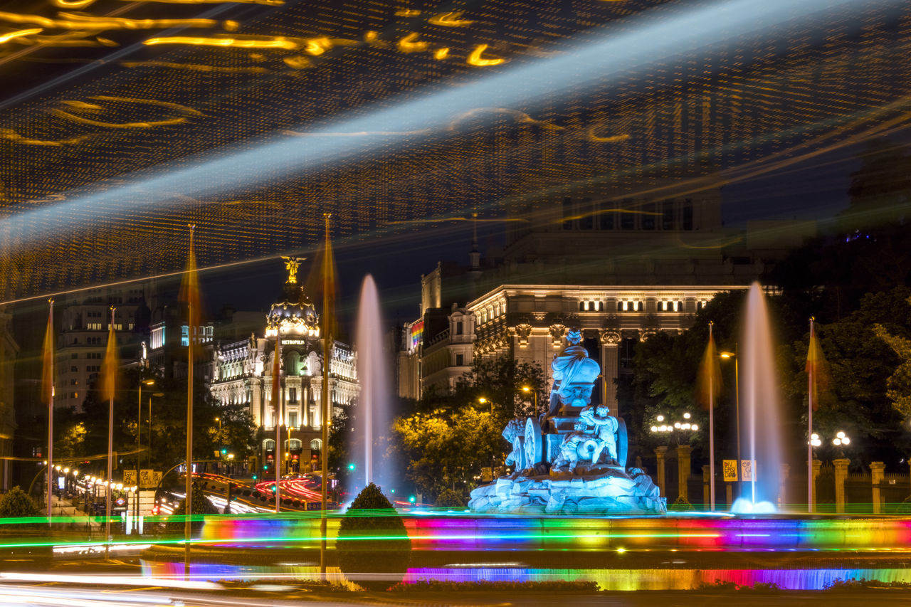 Architecture Blurred Motion Building Exterior Built Structure Carousel Cibeles City Colorful Illuminated Lgbt Light Trail Long Exposure Madrid World Pride Metropolis Motion Night Night Lights No People Outdoors Pride Speed Travel Destinations