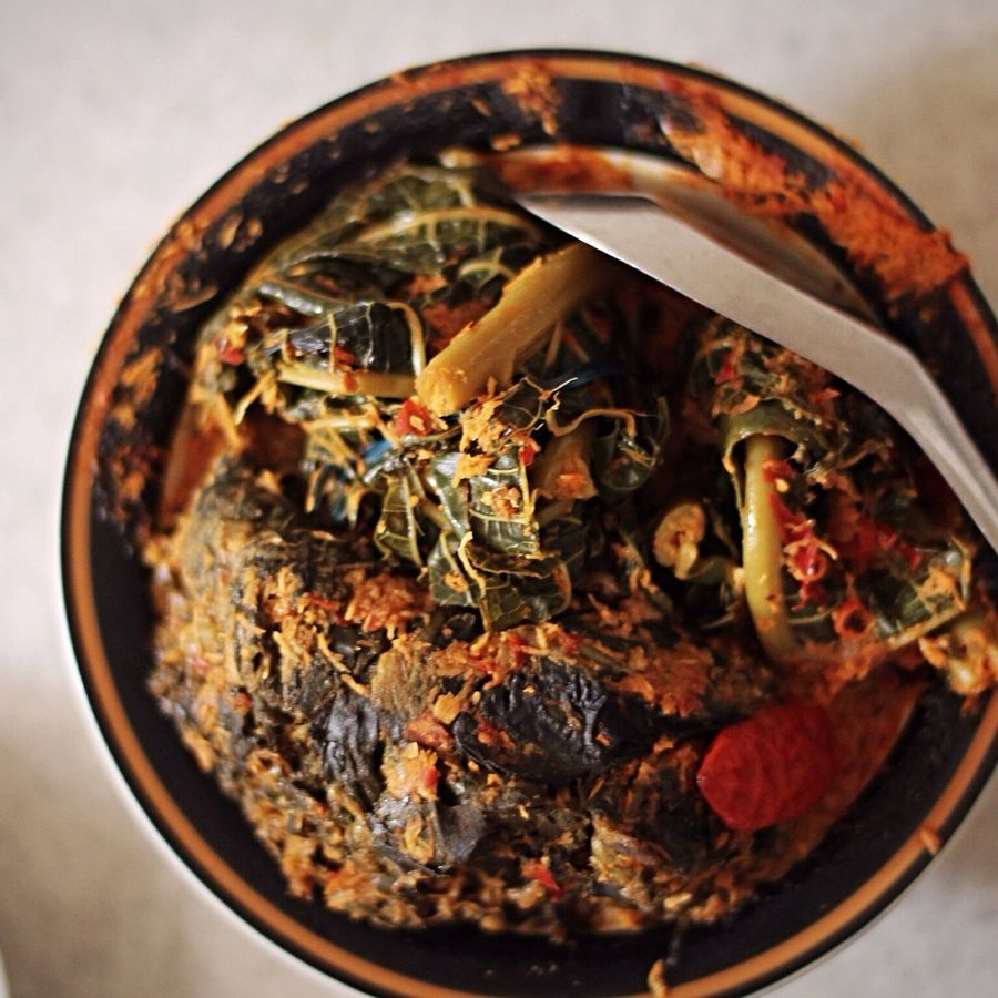 Urap daun pepaya Taking Photos Urap Daun Pepaya Indonesian Food Traditional Food Of Indonesia Persiapan Masak Local Food Cooking Preparation Cooking Close-up