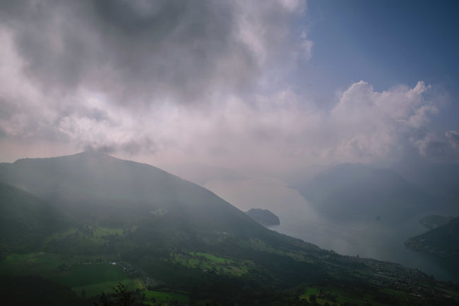 Beauty In Nature Calm Cloud Cloud - Sky Cloudy Day Foggy Growth Landscape Majestic Mountain Mountain Range Nature No People Non-urban Scene Ocean Outdoors Remote Scenics Sea Sky Solitude Tranquil Scene Tranquility Water