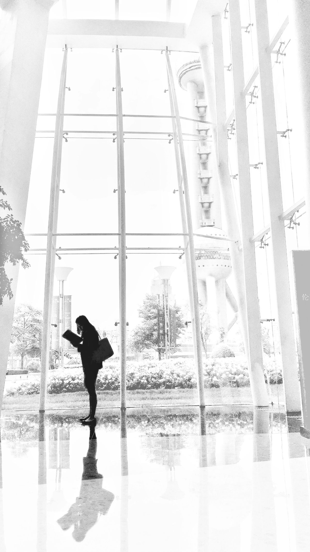 Time stood still, for her One Person Silhouette Built Structure Architecture Modern Building Lobby Glass Indoors  Real People Business Reading