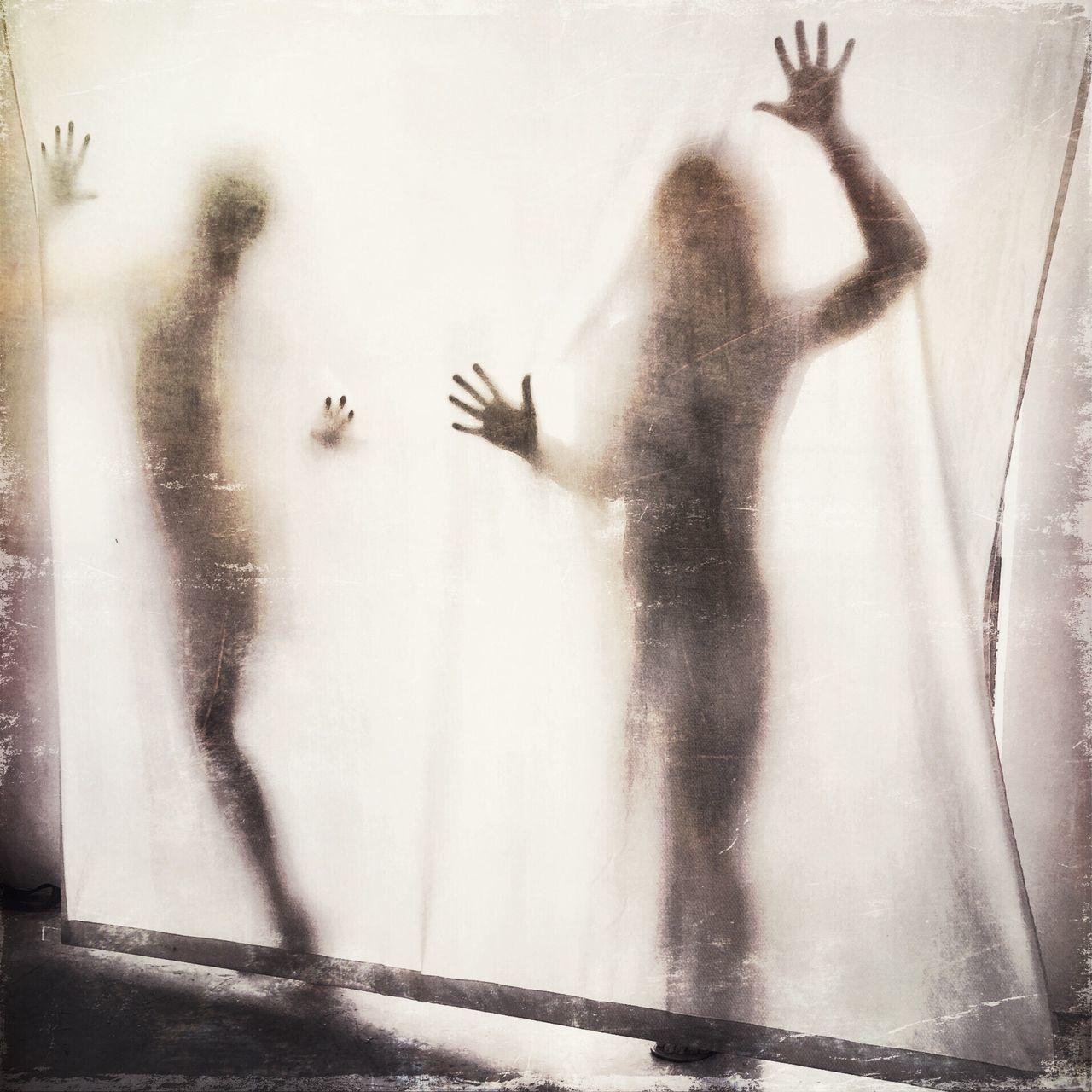 Two People Seeing Through White Textile