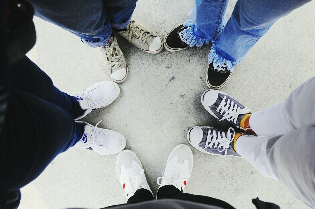shoe, low section, standing, human leg, high angle view, personal perspective, real people, directly above, human body part, men, canvas shoe, togetherness, friendship, lifestyles, day, teamwork, outdoors, adult, people