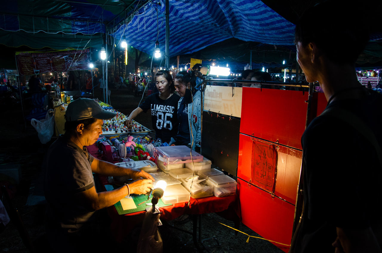real people, night, market stall, market, illuminated, food, men, food and drink, lifestyles, women, light bulb, outdoors, city, young women, young adult