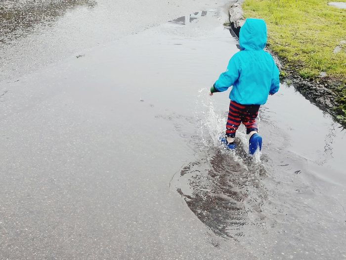 After Raining Outdoors Boy Wet Water