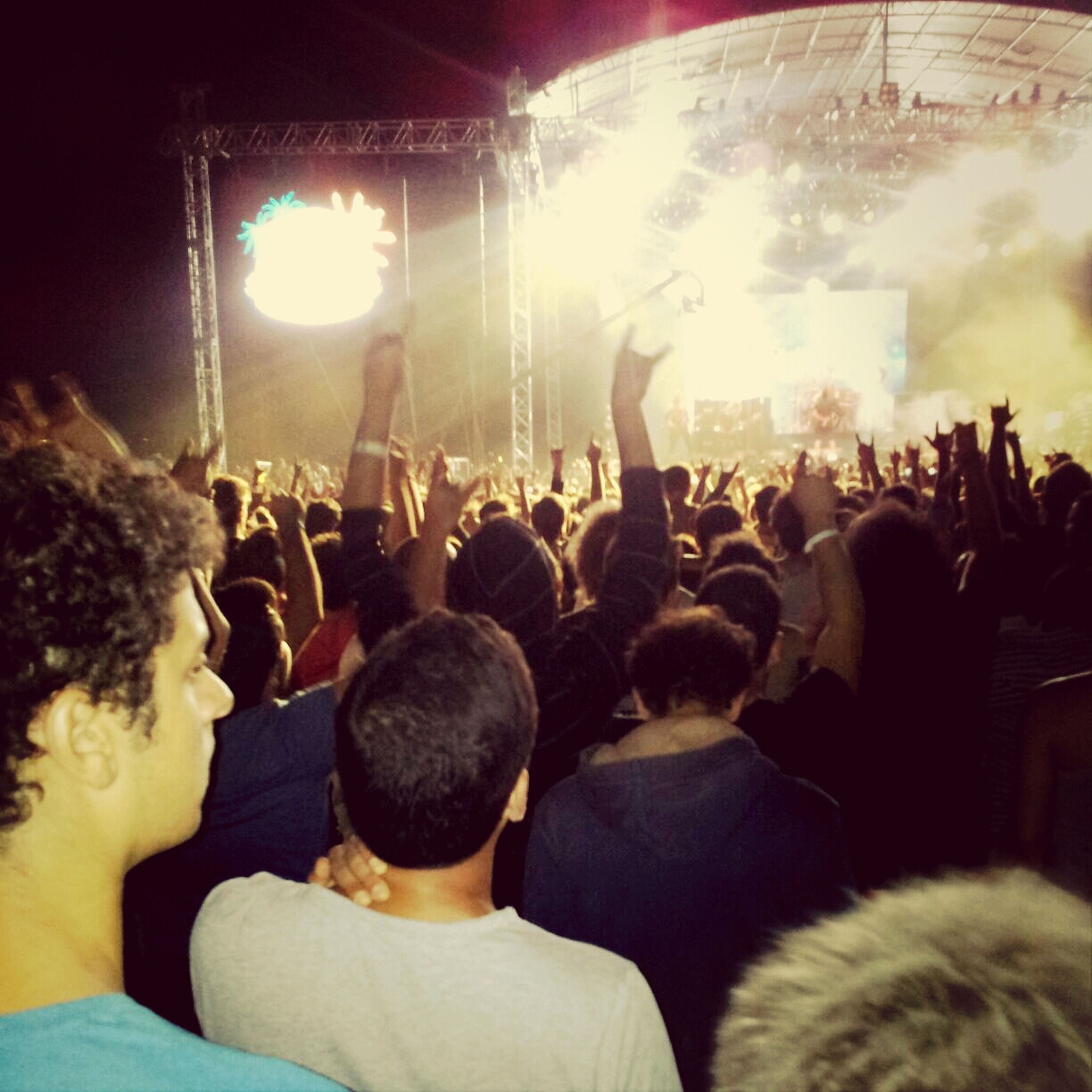 large group of people, crowd, lifestyles, men, person, leisure activity, illuminated, togetherness, indoors, arts culture and entertainment, night, music, enjoyment, event, fun, performance, music festival, popular music concert