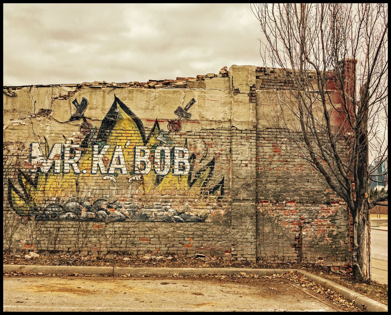graffiti, architecture, text, built structure, no people, day, outdoors, building exterior, sky, city, tree, close-up