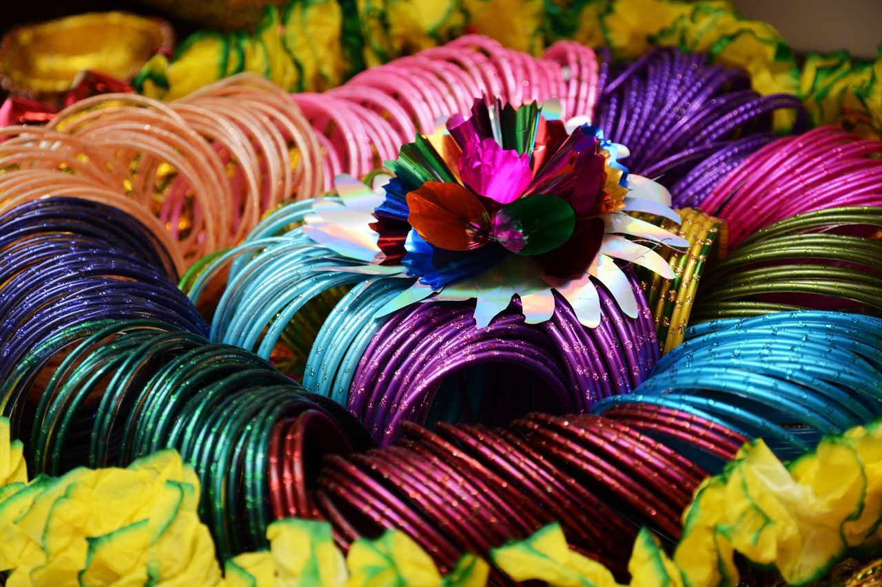 Beautifully Organized Indian Weddings  Indian Culture  Multi Colored Close-up Large Group Of Objects Variation Bangle No People Flower Indian Wedding Decorations Indian Wedding Mehndi Mehndi Night Sangeet Wedding Decoration Tradition Wedding Decor Celebration Wedding Details Mandala