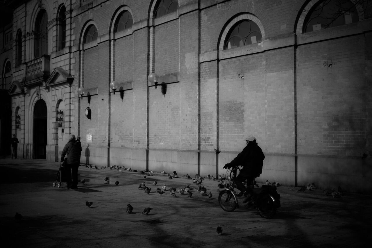 Real People Built Structure Building Exterior Architecture Transportation City Blackandwhite Photography Black & White Black&white Blackandwhite Black And White Black And White Photography Blackandwhitephotography Bicycle