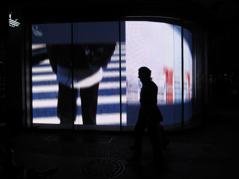 Woman passing by a storewindow in Berin Berlin Glass Glass - Material Lifestyles Light One Person Shopwindow Wall Window