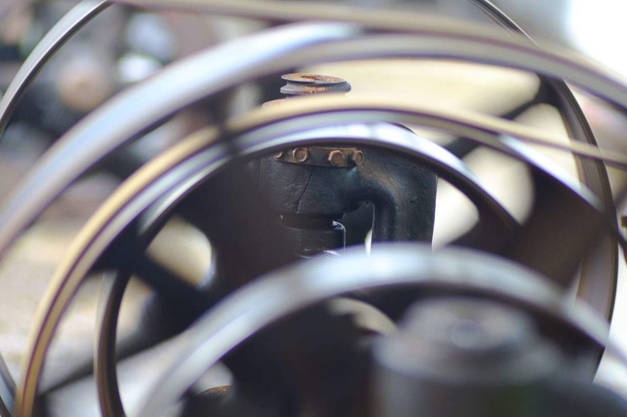 Old Fashioned Wheel Blurred Motion Close-up Drive Metal Motion No People Outdoors Selective Focus Technical Technology Turning Wheels