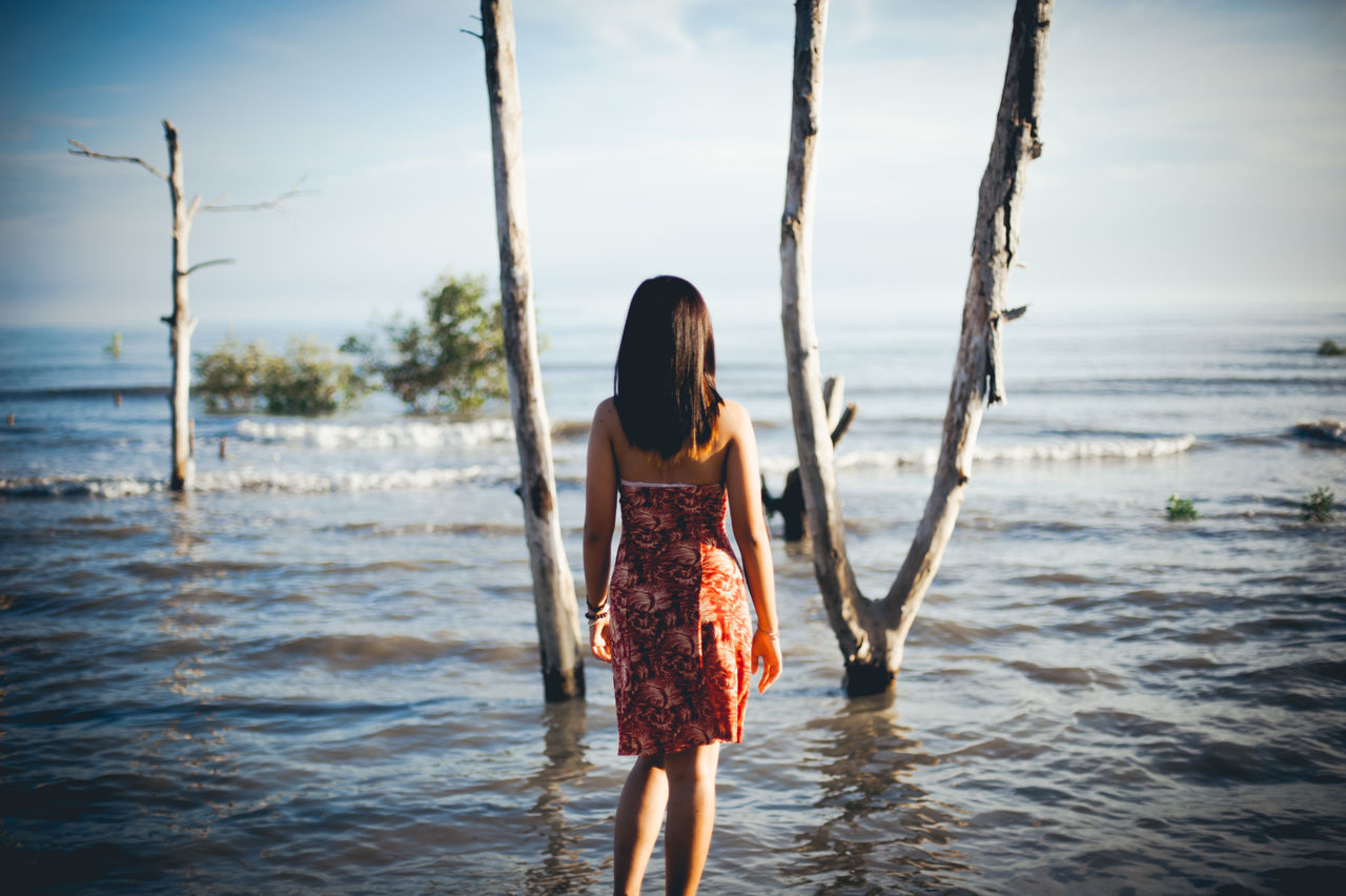 Ankle Deep In Water Beach Beauty In Nature Day Leisure Activity Lifestyles Nature One Person Outdoors Real People Rear View Sea Sky Standing The Great Outdoors - 2017 EyeEm Awards The Portraitist - 2017 EyeEm Awards Three Quarter Length Water Young Adult Young Women