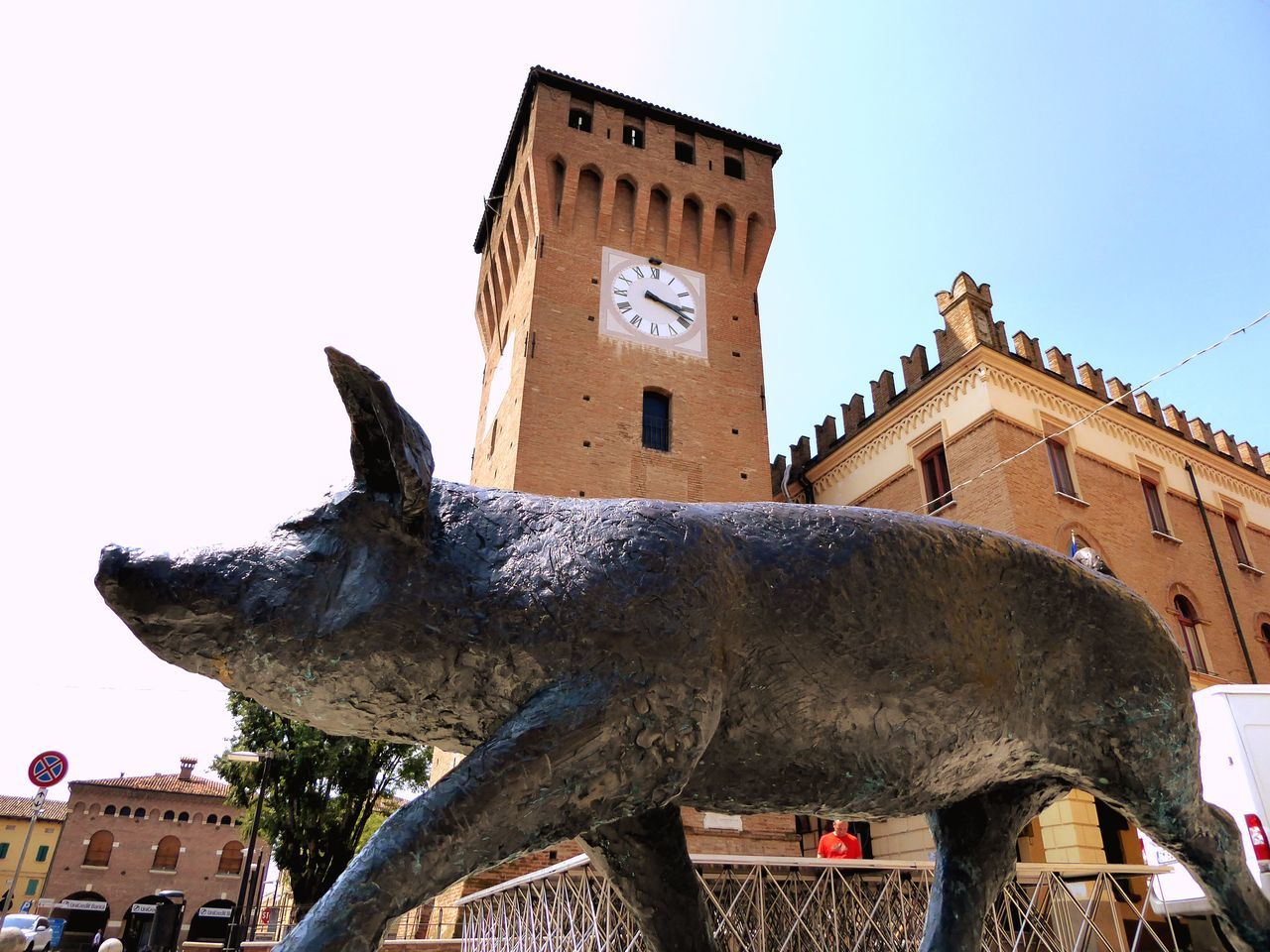 building exterior, architecture, built structure, animal representation, sculpture, statue, art and craft, low angle view, sky, history, gargoyle, outdoors, day, clock tower, no people, clear sky, animal themes