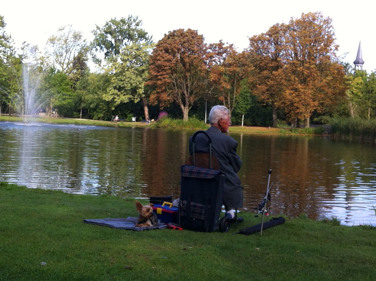 lake, sitting, water, tree, real people, leisure activity, rear view, nature, full length, senior adult, day, grass, outdoors, senior men, togetherness, lifestyles, beauty in nature, relaxation, men, mammal, sky, people
