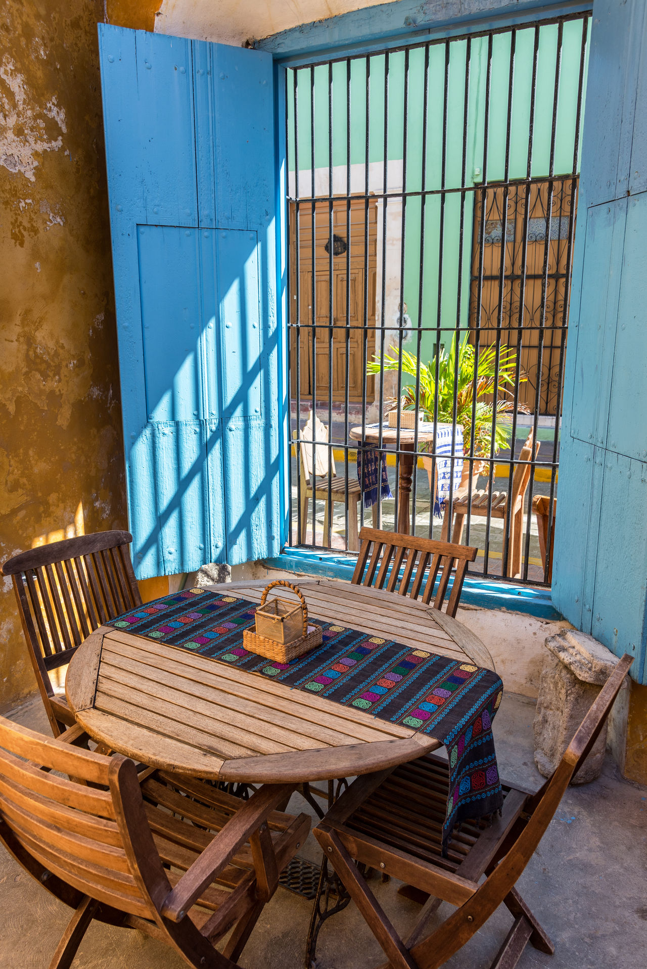 Small outdoor cafe in the historic colonial city of Campeche, Mexico America Architecture Building Campeche Caribbean City Cityscape Colonial Downtown Heritage Historic Houses Landmark Latin Mexican Mexico Spanish Square Street Town Unesco UNESCO World Heritage Site Urban Yucatan Mexico Yúcatan