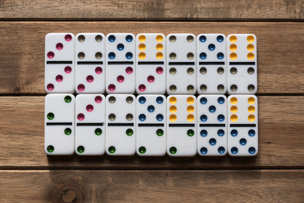 Dominoes on wooden table Close-up Dominoes Dominos Game In Row Indoors  Large Group Of Object Multi Colored No People Play Still Life Table Variation Lights White Wood - Material Wooden