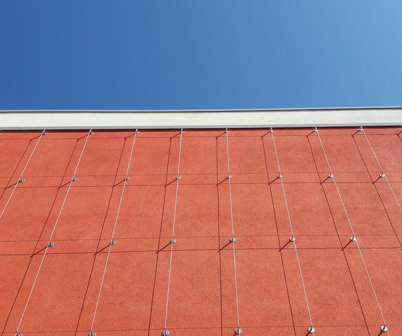 Architecture Modern Architecture Facade Detail Facade Colours Façade Urban Geometry Pattern Outdoors Trellis Weir No People Architecturephotography Architectural Detail Patterns Urban Geometry. Looking Up Blue Sky Copyspace Day Red Built Structure Shadows Shadow And Light The Architect - 2017 EyeEm Awards