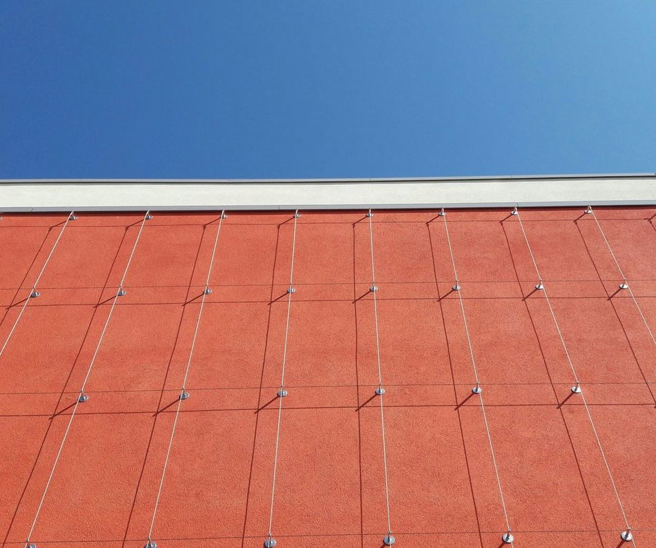 Architecture Modern Architecture Facade Detail Facade Colours Façade Urban Geometry Pattern Outdoors Trellis Weir No People Architecturephotography Architectural Detail Patterns Urban Geometry. Looking Up Blue Sky Copyspace Day Red Built Structure Shadows Shadow And Light