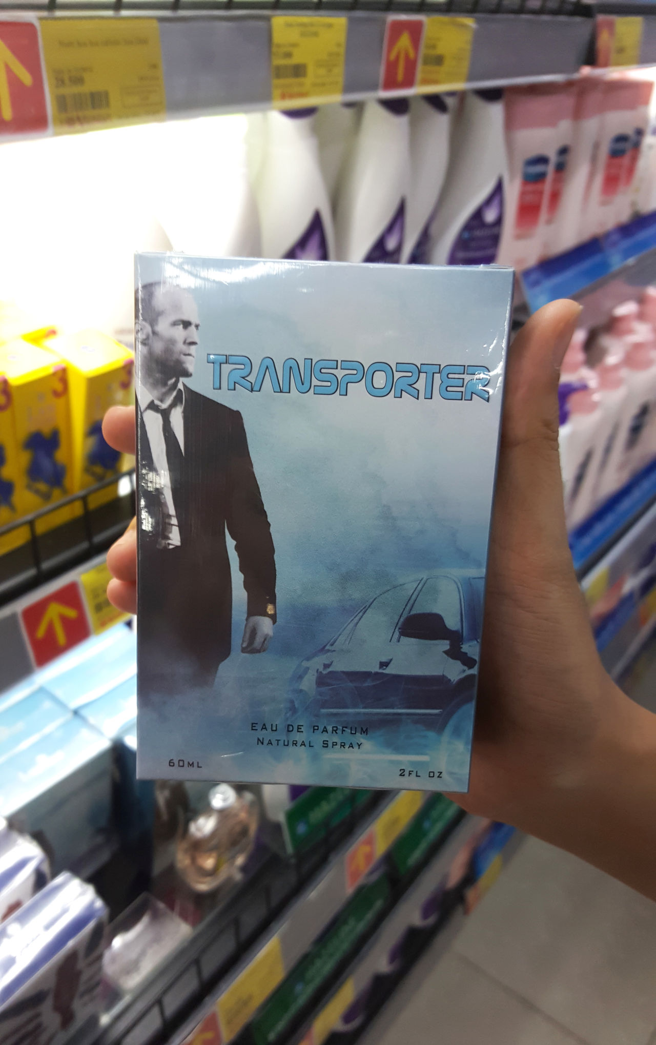Movie-inspired packaging for Vietnamese deodorant, in Da Nang supermarket. Actors Actors & Actresses Buying Characters Da Nang Deodorants Design Editorial  Holding Indoors  Jason Statham Moviestar Packaging Products Supermarkets Text Transporter Vertical Vietnam Western Script