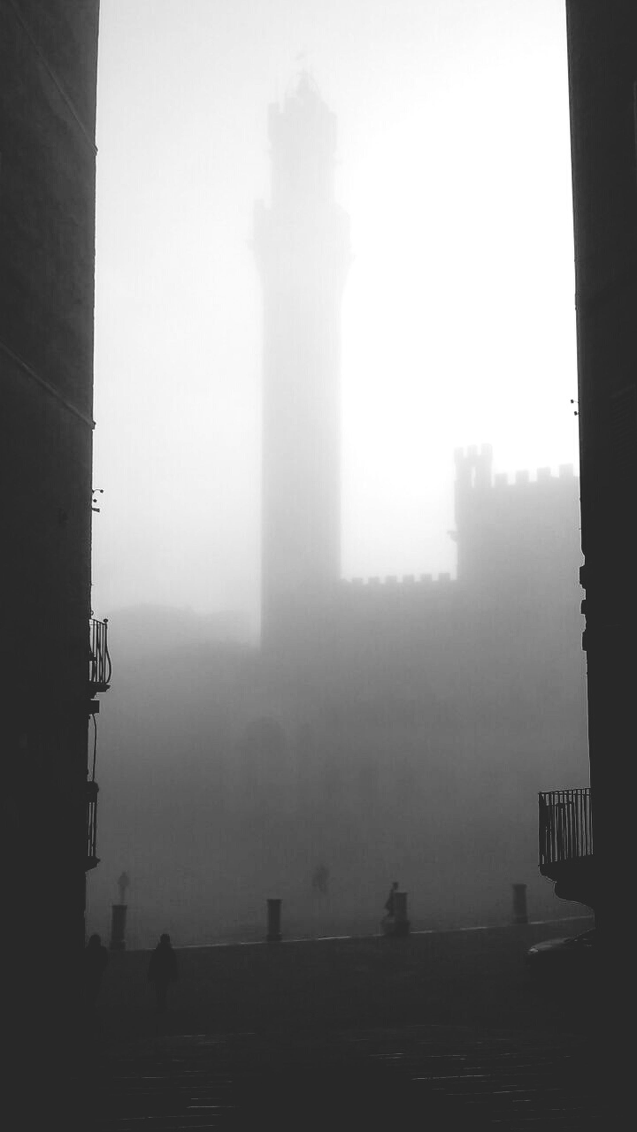 silhouette, fog, built structure, architecture, foggy, building exterior, sky, copy space, city, weather, outdoors, tranquility, nature, dusk, day, building, outline, water, no people