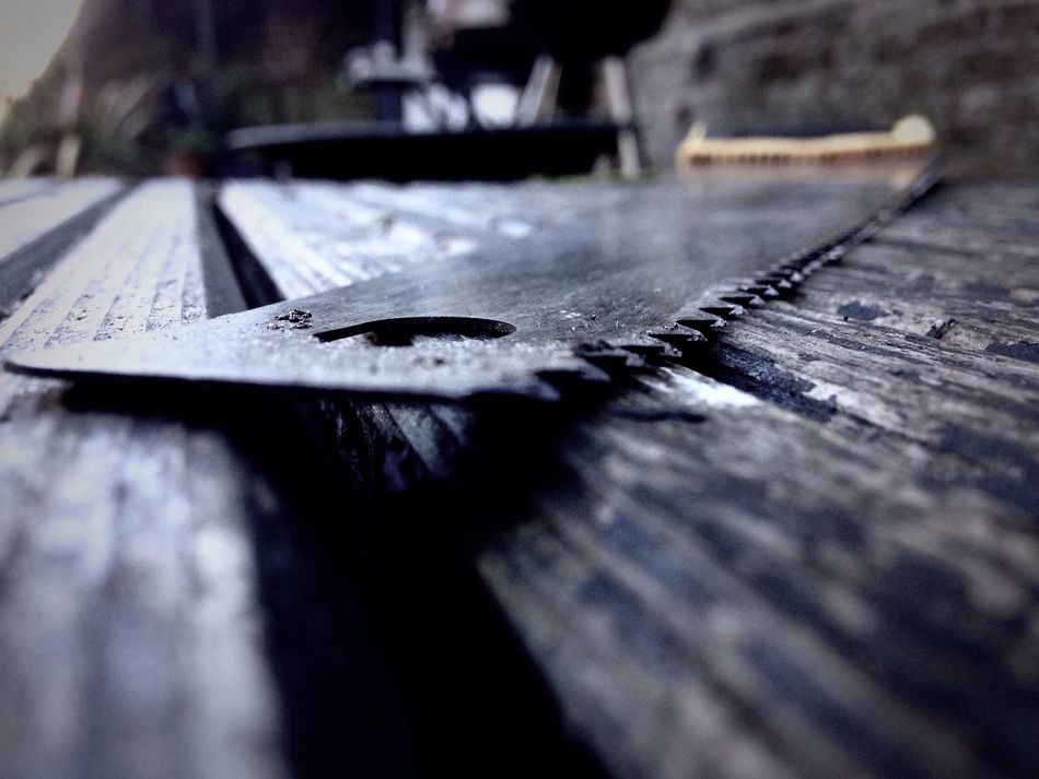 Grabbing the toolbox! Selective Focus Wet Surface Level No People Textured  Day Close-up Outdoors Rainfall DIY Saw Danger Desaturated Tool Tools Working Work IPhoneography Welcome To Black