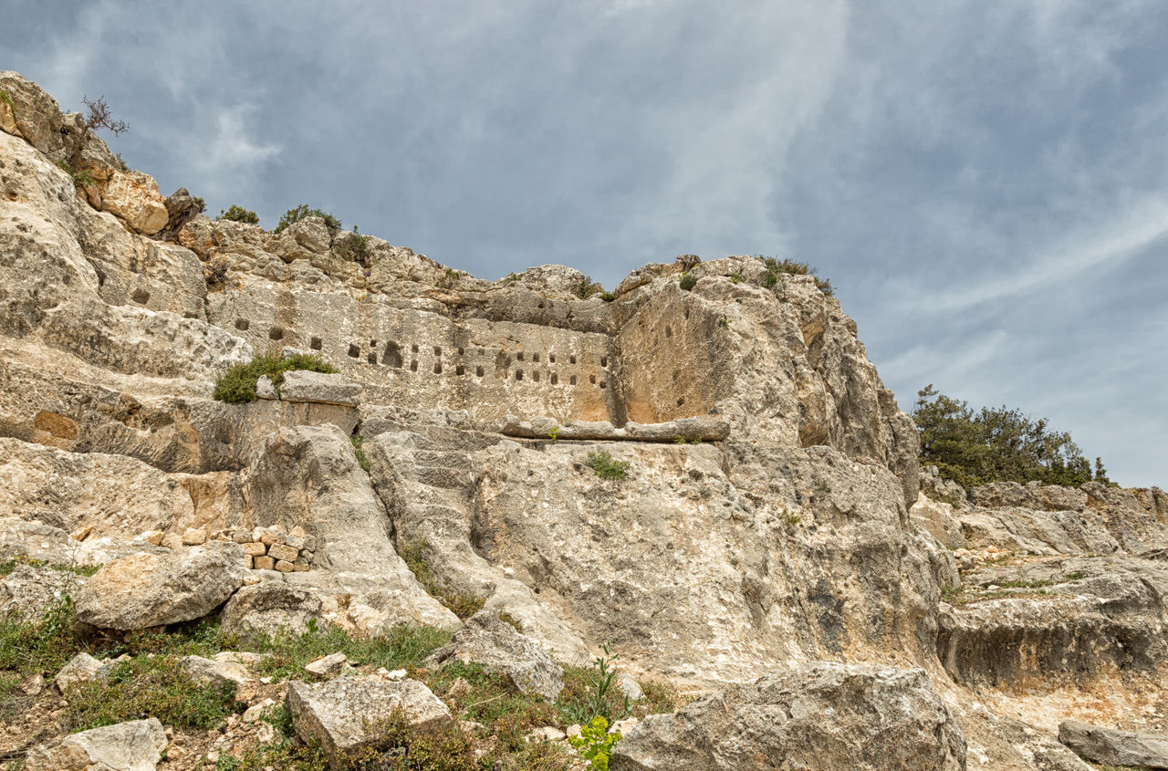 Alahan Monastery Alahan Monastery Alahan The Monastery Ancient Ancient Civilization Architecture Building Exterior Built Structure Cliff Cloud - Sky Faith History Monastery Mountain Mut Nature Old Ruin Religious  Religious Architecture Rock - Object Sky Stone Stone Material Travel Destinations Turkey