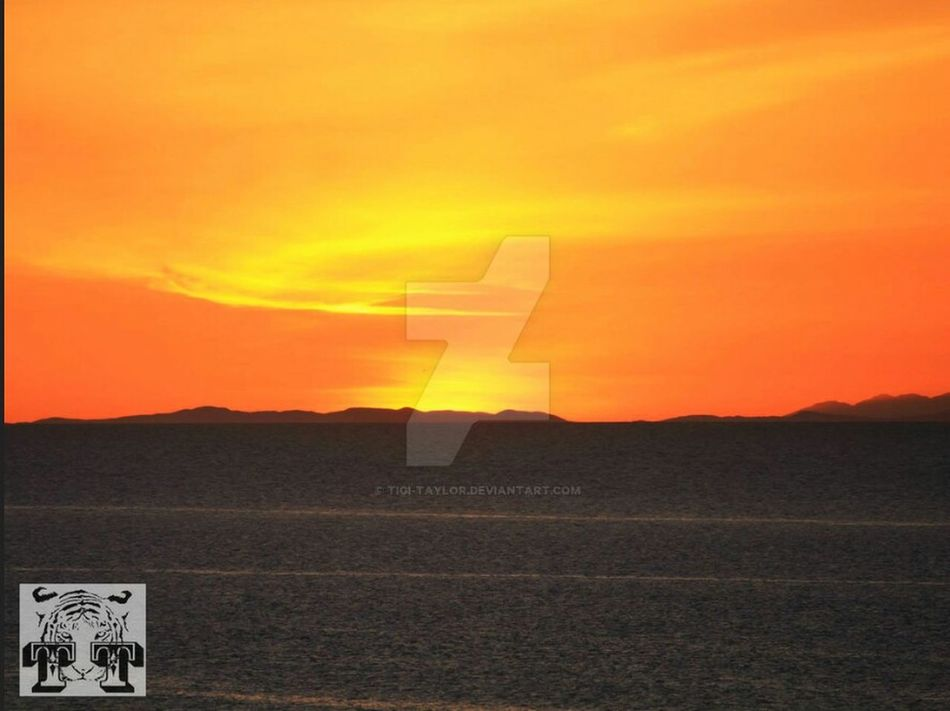 Taken from my DeviantArt account. The wonderful colours of a Scottish sunset with the Black Isles in clear view.