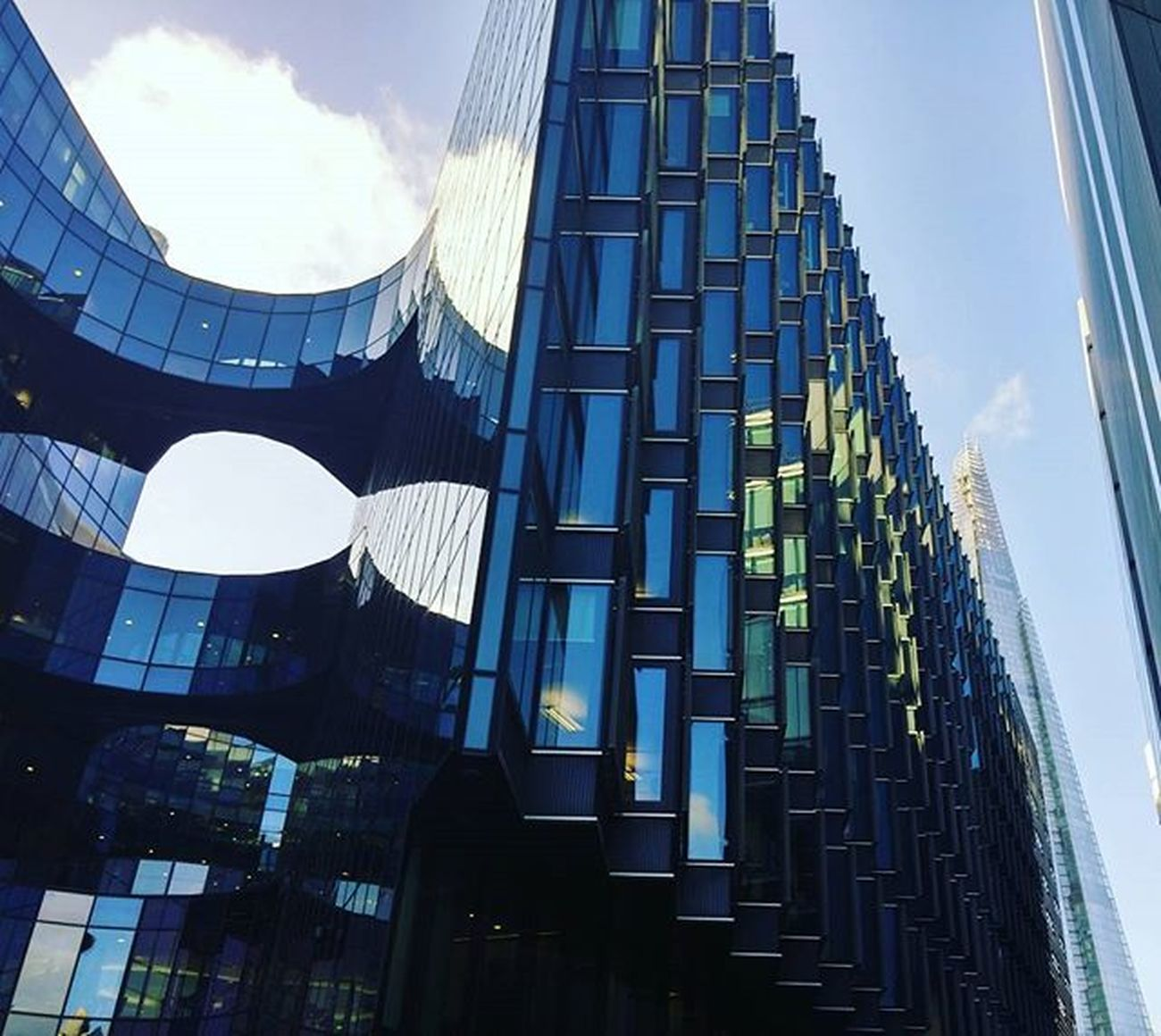 Modern glass architecture, with the Shard in the background. Glassbuildings TheQueensWalk Theshard London