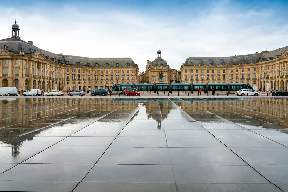 Architecture Building Exterior City Cityscape Day History Human Eye Outdoors People Place De La Bourse Reflection Reflection Sky Travel Destinations Water