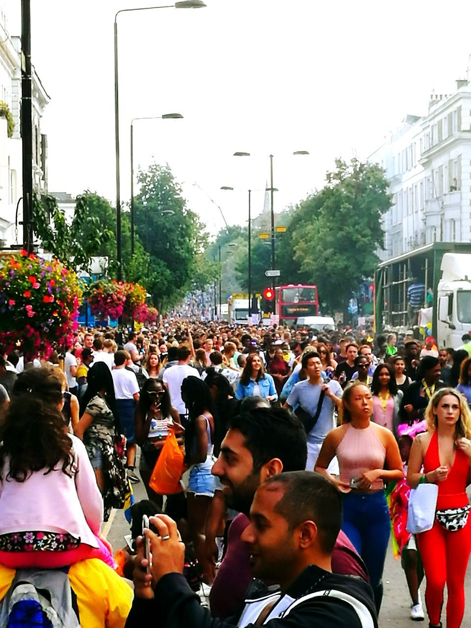 large group of people, real people, crowd, men, street, tree, women, togetherness, day, city, building exterior, lifestyles, architecture, outdoors, built structure, protestor, road, sky, people