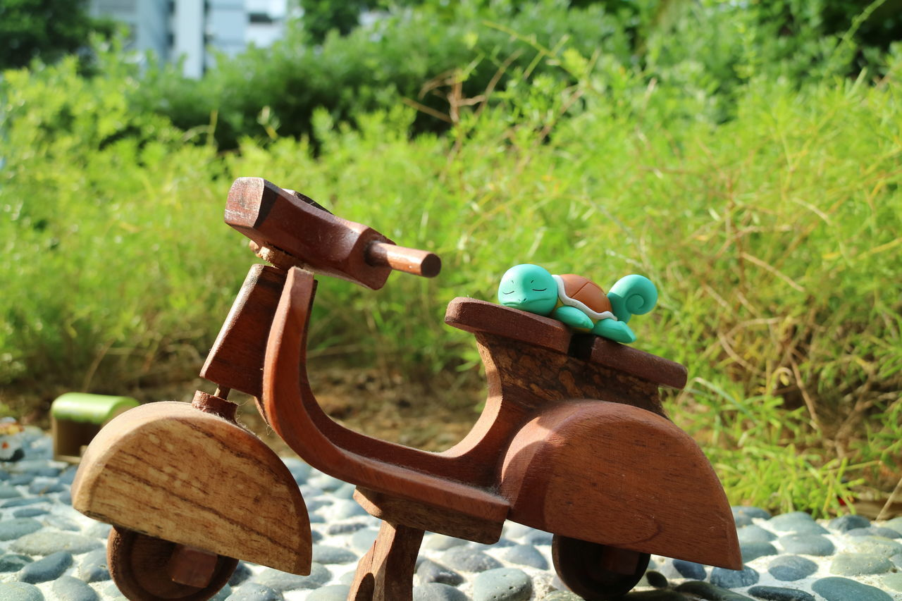 Close-up Day EyeEm Gallery Eyeem Singapore Focus On Foreground Green Color Man Made Object Outdoors Pokemon Go Toys Wooden Bike
