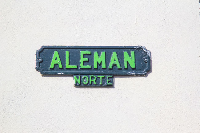 Aleman Blue Close-up Cuba Day Green Color Information Mejunje Multi Colored No People Outdoors Santa Clara Side By Side Street Sign Street Sign In Cuba