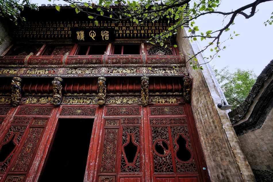 China Photos Traditional Wooden Structure Taking Photos Urban Village Travel Urban Life Urban Geometry Urban Architecture Low Angle View Light And Shadow Built StructureFull Frame Building Exterior Architecture No People Tree Day Outdoors Place Of Worship Sky Streamzoofamily Friends Streamzoofamily