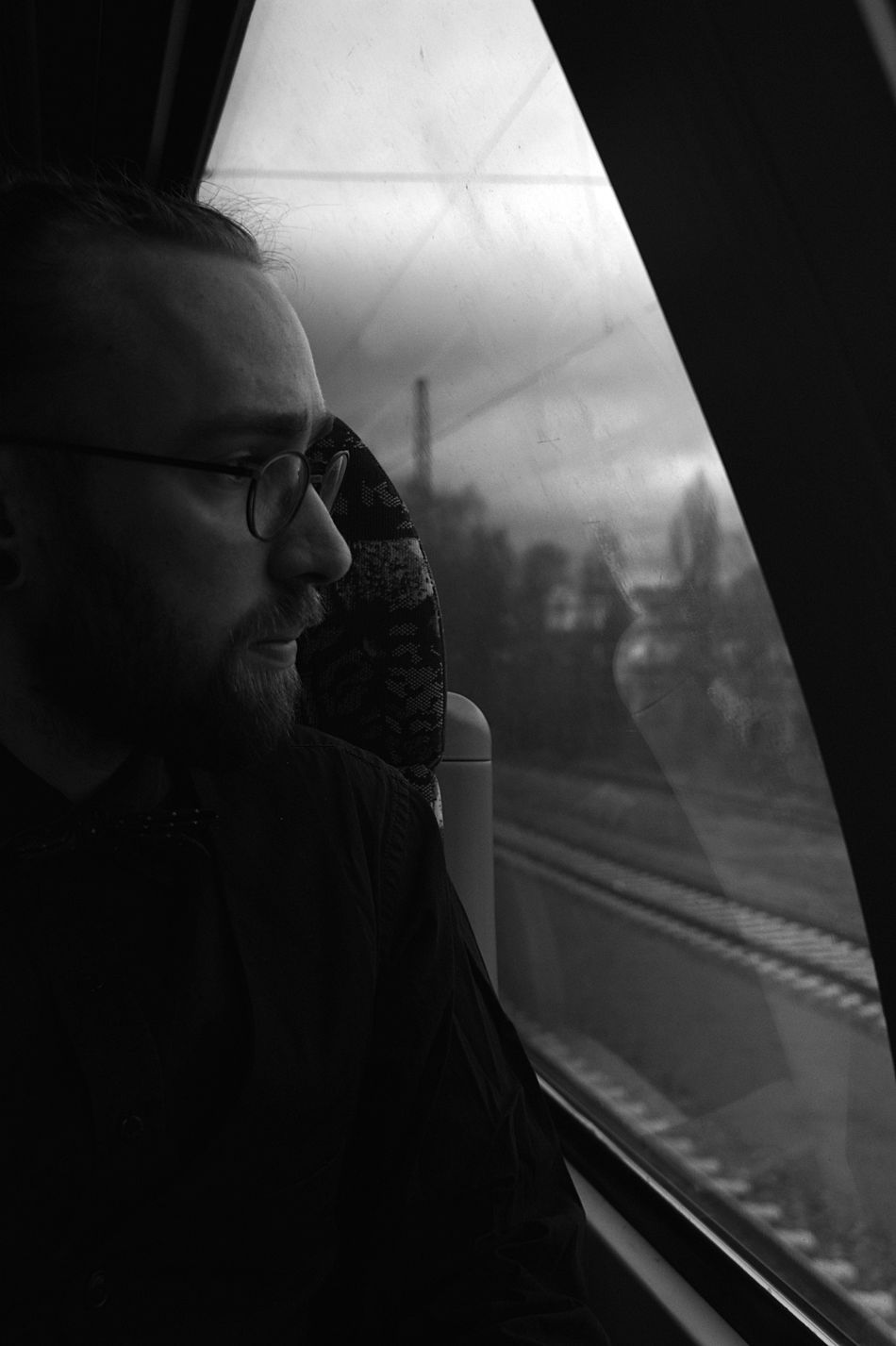 Adult Adults Only Blackandwhite Photography Close-up Contemplation Day Indoors  Men One Man Only One Person Pensive People Sitting Sky Thinking Train Ride Waiting Window Young Adult Welcome To Black