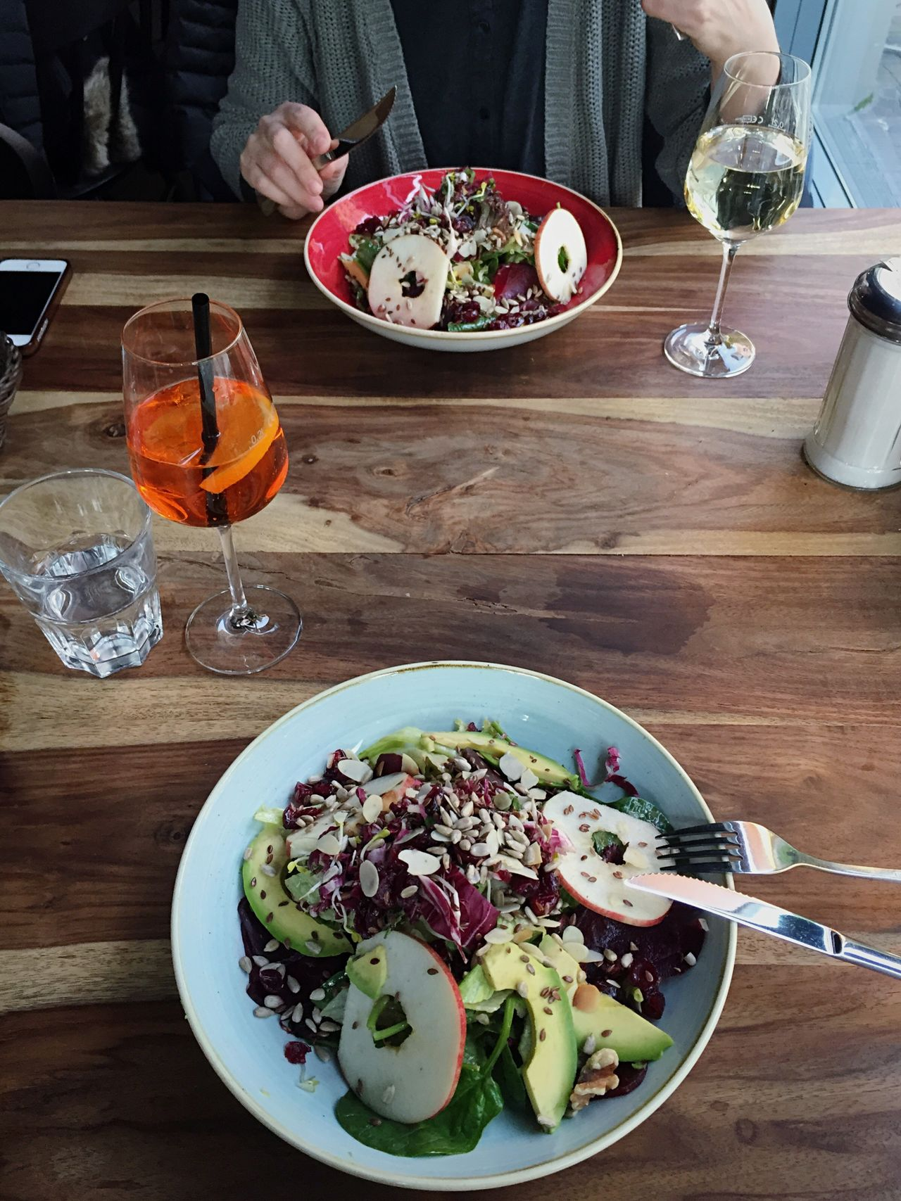 Dinner with a friend. After work drinks Table Plate Food And Drink Salad Freshness Healthy Eating High Angle View Bowl Drinking Glass Healthy Lifestyle Fork Indoors  Ready-to-eat Refreshment Food Vegetable Serving Size Salad Bowl Drink Lettuce Vegan Vegetarian Food Healthy Berlin Restaurant