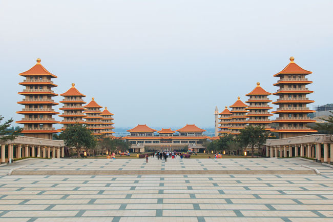 Kaohsiung, Taiwan - December 15, 2014: Sunset at Fo Guang Shan buddist temple of Kaohsiung, Taiwan with many tourists walking by. Architecture ASIA Asian  Asian Culture Buddha Buddha Statue Built Structure Day Fo Guang Shan Kaohsiung Outdoors Religion Sky Summer Taiwan Tourism Tradition Travel Destinations