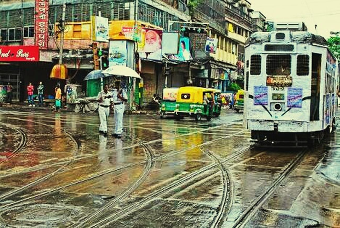 Wet Rain Rainy Season Water City Outdoors Cloud - Sky Landscape Photography Trams Traffic Police  Day Kolkata Beauty Of Kolkata Crossing Sky Peoples People And Places