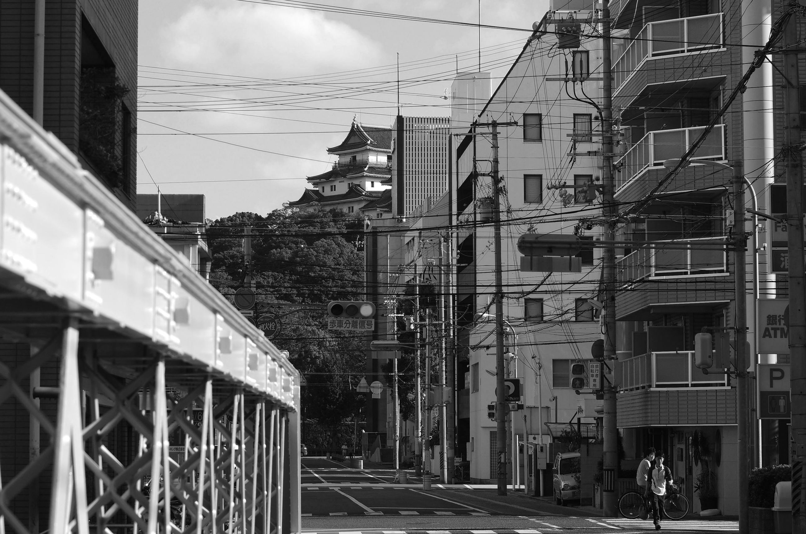 architecture, building exterior, built structure, residential building, building, residential structure, power line, transportation, cable, city, sky, street, house, the way forward, window, day, outdoors, railing, no people, diminishing perspective