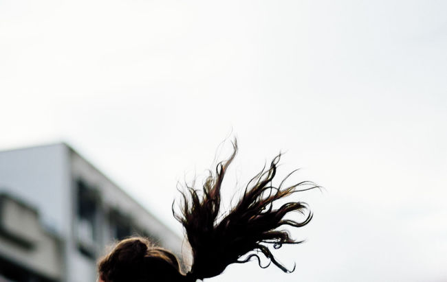on the fly Capturing Motion Cheerleader Copy Space Flying Focus On Foreground Hair Negative Space Sky Streetphotography Unrecognizable Person