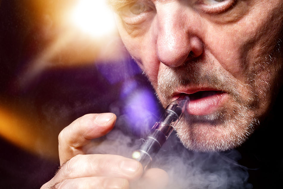 close up portrait of a man smoking an e-cigarette Bokeh Cigarette  Close-up E-Cigarette Ecig Ecigs Equipment Health Inhale Lifestyles Lights Male Man Modern Mouth Nicotine Portrait Smoke Smoking Studio Shot Technology Vapes Vapor