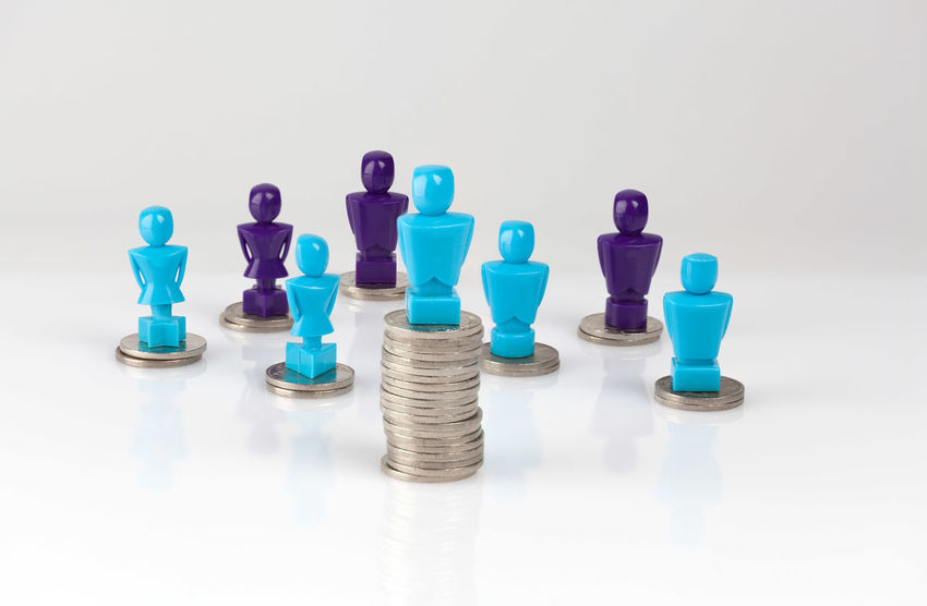 Wage gap and unequal money distribution concept shown with male and female figurines standing on coin piles Copy Space Arrangement Chess Chess Piece Close-up Coins Concept Conceptual Day Female Figurine  Figurines  Gender Equality Gender Gap In A Row Indoors  Large Group Of Objects Male No People Still Life Strategy Studio Shot White Background