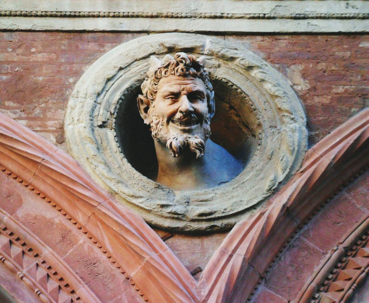 human representation, statue, male likeness, sculpture, low angle view, art and craft, female likeness, religion, day, spirituality, outdoors, no people, place of worship, built structure, architecture, close-up
