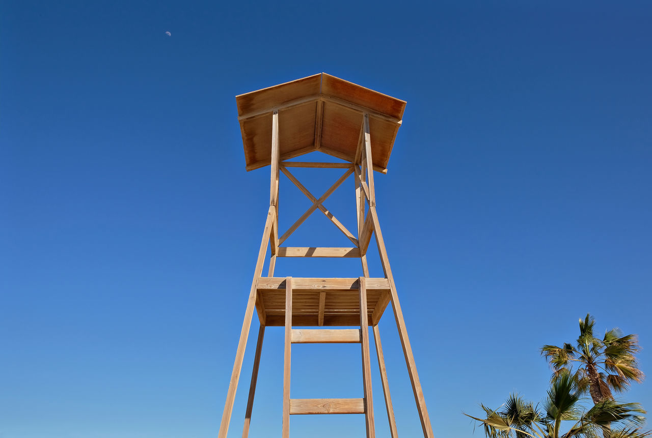 Bay Watch Beach Life Blue Clear Sky Day Height Lifeguard Tower Look-out Low Angle View Moody Sky No People Outdoors Safety Sky