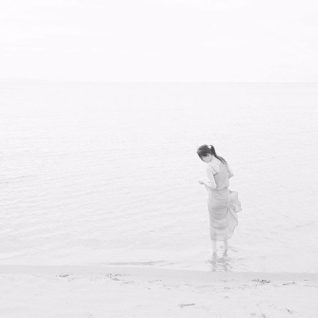 Nature Lifestyles NEM Memories One Person Standing Outdoors Sea Beach Water Beauty In Nature Women People Of The Oceans Monochrome White The Week Of Eyeem Portrait Of A Woman EyeEm Gallery Eye4photography  Hello World Taking Photos People Capture The Moment EyeEm Best Shots Memories Solitude