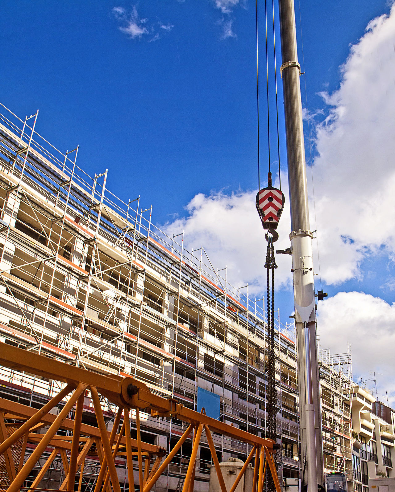 Building under construction Apartments Architecture Blue Building Exterior Built Structure Business Cloud - Sky Commercial Commercial Dock Contructionwork Crane Day Engineering Industry Low Angle View No People Outdoors Real Estate Residential Structure Scaffolding Sky Urban Work