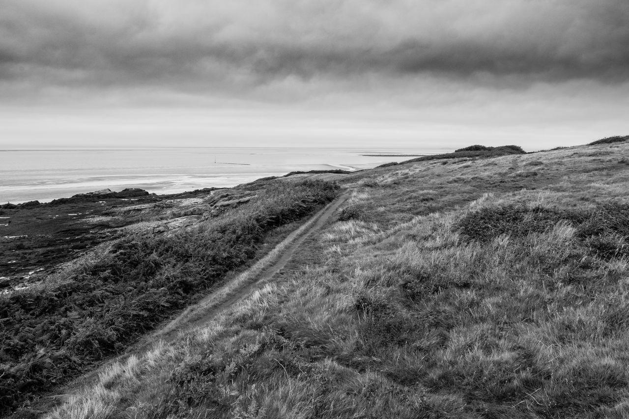 idmphotographer.com Beach Beauty In Nature Blackandwhite Cloud - Sky Cumbria Day Dramatic Sky Grass Heysham Coast Horizon Over Water Landscape Nature No People Outdoors Sand Sand Dune Scenics Sea Sky Tranquil Scene Tranquility Water